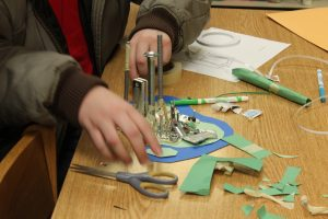 Youth using metal materials and paper circuits to create a 3D city.
